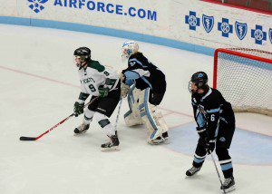 Reeths Puffer's  Andy DeYoung (9) screens Shores' Jacob VanderLee (30) on an early Puffer power play.  Photo/Eric Sturr