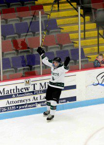 Reeths Puffer's Connor McEvoy (11) celebrates scoring RP's fourth goal.  Photo/Eric Sturr