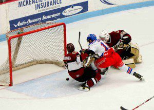 Shierhorn (29) and Corey Schueneman (7) somehow keep the puck out of the net. Photo/Eric Sturr