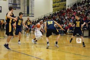Muskegon's Jason Loera dribbles through the Grand Haven defense. Photo/Jason Goorman