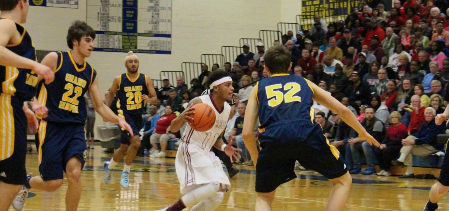 Big Reds race to another Class A district championship with a 72-48 whipping of Grand Haven [VIDEO]