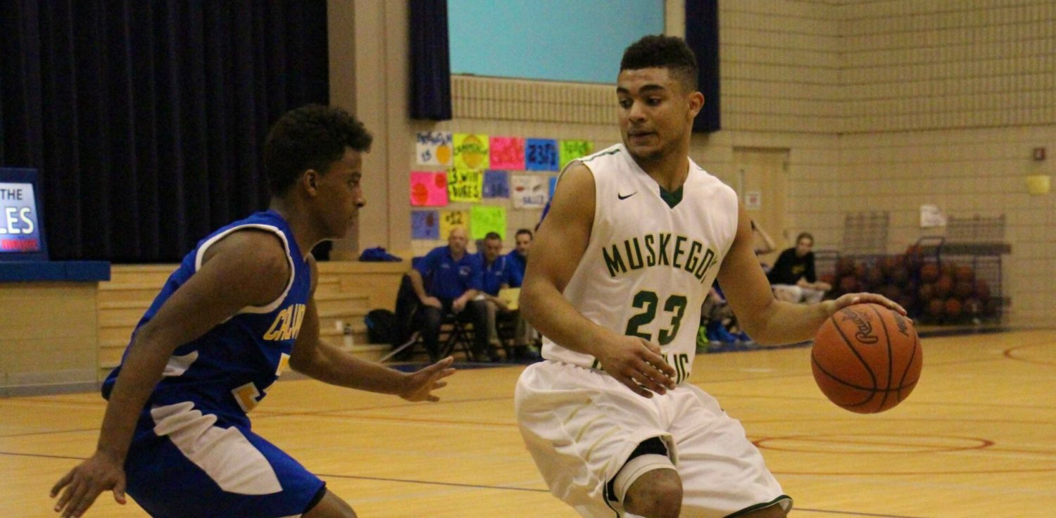 Muskegon Catholic plows past Fruitport Calvary Christian to claim its fifth straight district basketball title
