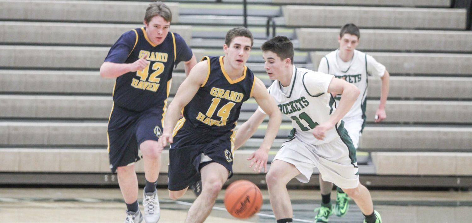 Grand Haven boys use tough third quarter defense to defeat Reeths-Puffer 54-48 in non-league hoops