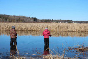 Husband-wife team Chuck and Adrian Woodland fish on the Pentwater River Saturday morning. Photo/Jason Goorman