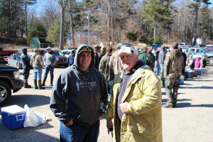 Mike Taylor and Chuck Woodland stand in front of area anglers in line for the weigh-in. Photo/Jason Goorman
