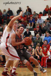 Kyle Zietlow drives to the basket for Spring Lake. Photo/Carol Cooper
