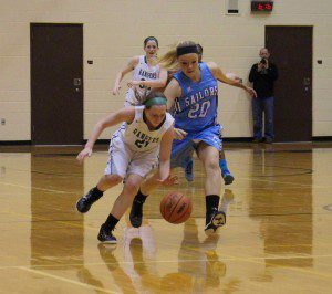 Mona Shores' Mackenzie Quinn goes for the loose ball against No. 21 Madi Winter. Photo/Jason Goorman