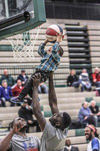 Members West Michigan lift a young fan up to the rim for the dunk during halftime. Photo/Joe Lane