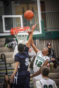 Reeths-Puffer's Jalen Cooley goes for the block against Wilber Dunbar. Photo/Joe Lane