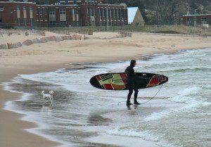 Chris Mattesson checks check in on his dogs on Pere Marquette Beach. Photo/Jason Goorman