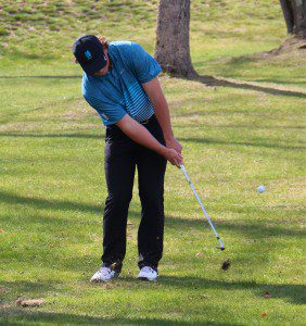 Mitchell White chips for the green during the GMAA city golf tournament. Photo/Jason Goorman