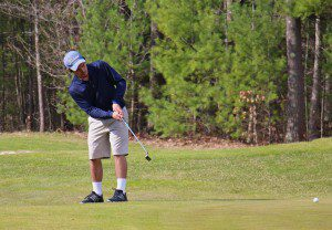 North Muskegon's Will Meirz puts on No. 4 at Stonegate Golf Club. Photo/Jason Goorman