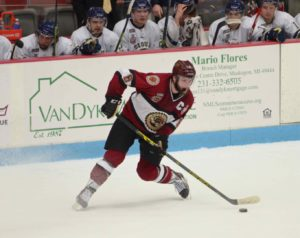 Christian Wolanin looks to send the puck up the ice for Muskegon. Photo/Marc Hoeksema