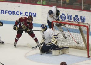 Muskegon's Mason Jobst (26) misses just wide early in the contest.  (Photo/Eric Sturr)