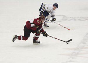 Corey Schueneman (7) races the puck up ice past Sioux Falls Mikey Eyssimont (11).  (Photo/Eric Sturr)