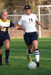 Marissa Hassevoort dribbles the ball up the field against Grand Haven earlier this season. Photo/Brian Wershem