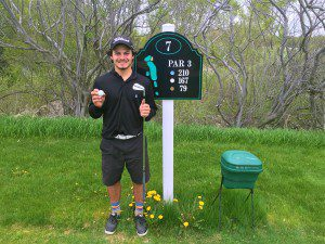 Will Mierz after hitting a hole in one on No. 7 at Lakeside Links in Ludington.