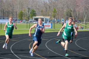 Western Michigan Christian's Elijah VanderVelde (right) runs next to Fruitport's Brice Wahr as WMC's Max Purvis trails during the 200 prelims. Photo/Jason Goorman
