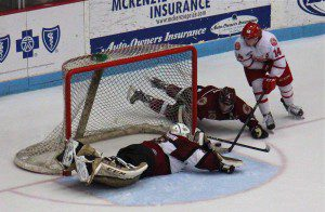 Muskegon goaltender Eric Schierhorn makes an incredible diving save with Dubuque's No. 14 Nate Sucese on the door step. Photo/Jason Goorman