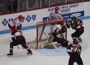 Eric Schierhorn makes one of his 46 saves for Muskegon. Photo/Jason Goorman