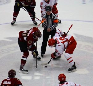 Matej Paulovic goes for the face off against Dubuque's Evan Smith. Photo/Jason Goorman