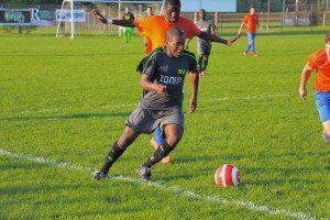 Muskegon's No. 3 Bandile Mathandela brings the ball up the sideline. Photo/Jason Goorman