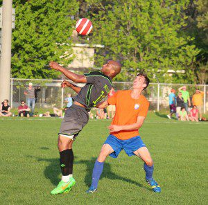 No. 10 Jeff McClure heads the ball for Muskegon. Photo/Jason Goorman