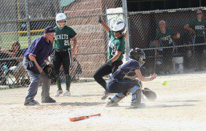 Reeths-Puffer's Jayla Olson gets home safely. Photo/Scott Stone