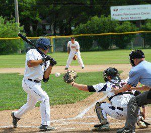 Muskegon's Nick Holt avoids the inside pitch. Photo/Scott Stone