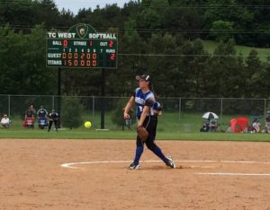 Kenadee Shugars throws the opening pitch of Montague's quarterfinal win over Traverse City St. Francis. Photo/Julie Rice