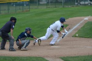 Kyle Wise lays down the sacrifice bunt for Muskegon during Game 1 action. Photo/Marc Hoeksema
