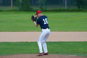 Fremont pitcher Jake Burt pulls in from the stretch to deliver the pitch. Photo/Marc Hoeksema