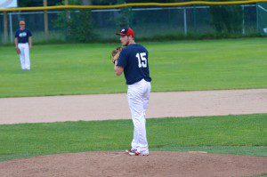 Fremont's Christian Wade gets ready to throw the pitch. Photo/Marc Hoeksema
