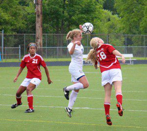 Spring Lake's No. 18 Kaley George reaches for the header. Photo/Jason Goorman