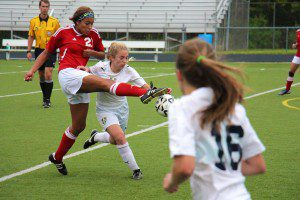 Margan Carey goes for the loose ball with Dewitt's Dainelle Stephan. Photo/Jason Goorman
