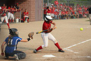 Holton's No. 11 Ashley Friend takes a swing during the fourth inning of action. Photo/Jason Goorman