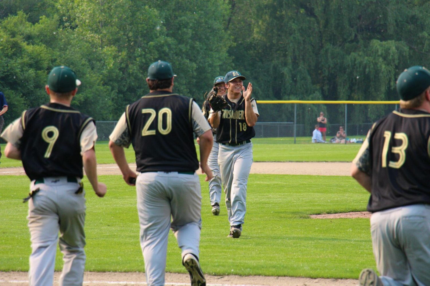 Muskegon Catholic baseball team gets past Potterville 2-1, needs two more wins for a Division 4 state title