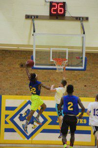 Joeviair Kennedy goes in for the dunk. Photo/Jason Goorman