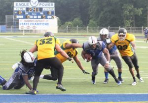 Eric James rushes in for a Mustang two-point conversion. Photo/Scott Stone