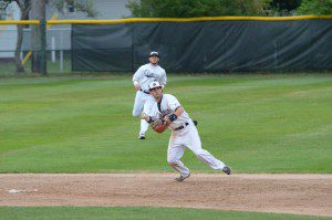 Muskegon's Connor Seymour takes the grounder and gets ready to throw to first base. Photo/Marc Hoeksema