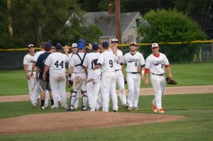The Muskegon Clippers celebrate after winning. Photo/Marc Hoeksema