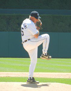Gawkowski in the middle of his pitching windup at Comerica Park.
