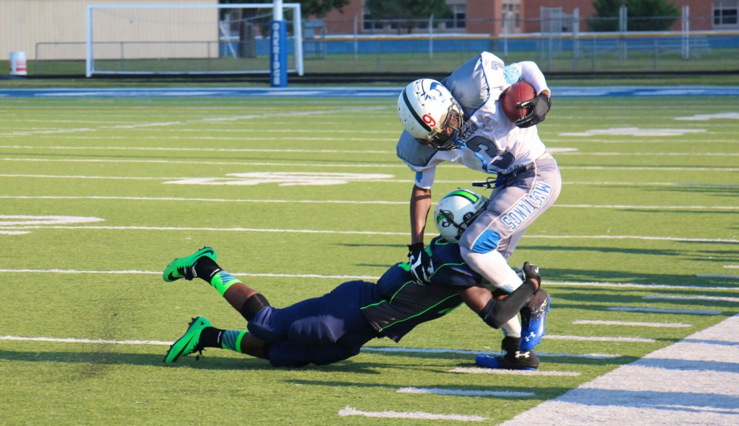 Muskegon Mustangs wrap up regular season with blowout victory, 56-6 over the Lakeshore Cougars [VIDEO]