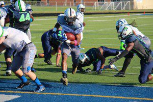 No. 5 John Ross breaks through the end zone for a Mustang touchdown. Photo/Jason Goorman