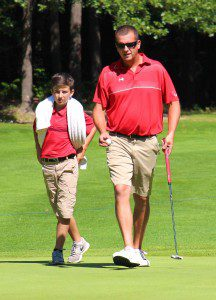 Jeff Petrosky gets counsel from his son Cody during Sunday's action. Photo/Jason Goorman