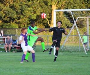 The Riser's Bandile Mathandela leaps for the lose ball. Photo/Jason Goorman