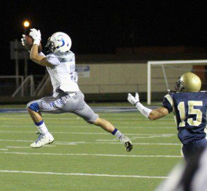 Buddy Keys comes up with an interception for the Mustangs. Photo/Scott Stone