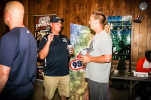 Fruitport head football coach Greg Vargus talks with Mona Shores Athletic Director Ryan Portenga. Photo/Tim Reilly