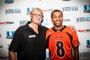 LSJ Publisher Jason Goorman stands with Muskegon Heights football player Devon Kitchen. Photo/Tim Reilly