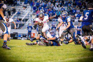Montague defense wrapps up OV quarterback Jayden Day. Photo/Tim Reilly